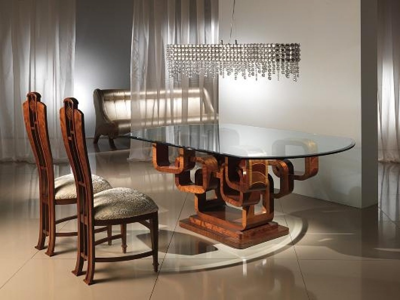 Mesas y sillas barrocas modernas im genes y fotos - Modern glass top dining table creating mesmerizing interior settings ...