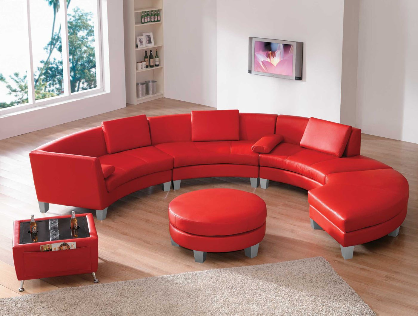 Sof circular de tonos rojos im genes y fotos for Colores de muebles modernos